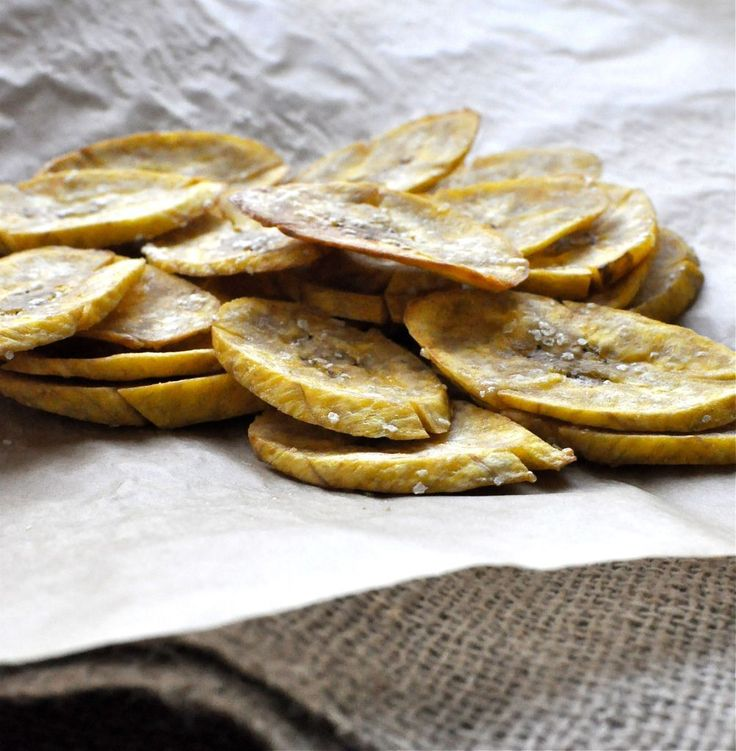 Baked Plantain chips with coconut oil. Use vegetable slicer at an angle to make thin and long.