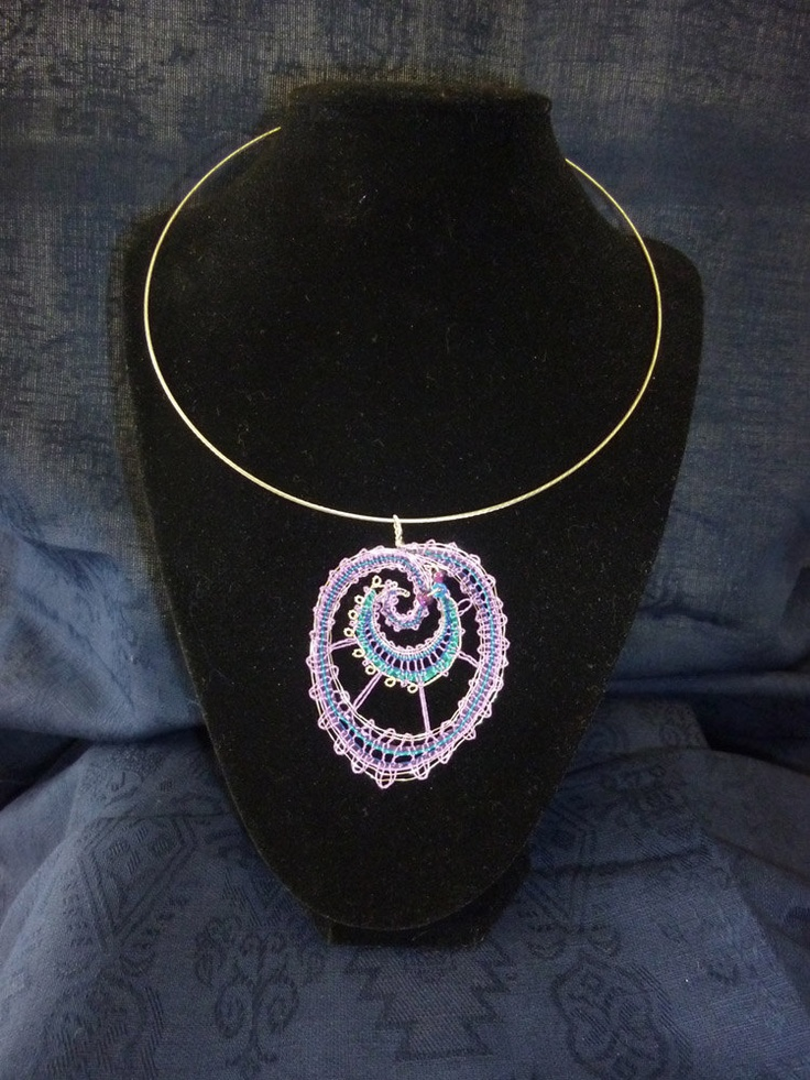 Handmade bobbin lace pendant with silver wire and purple and blue thread on a neck ring.. $55.00, via Etsy.