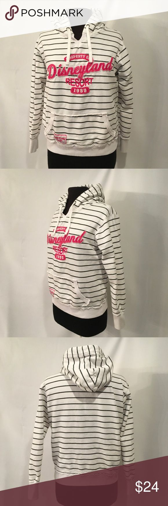 """Authentic Disney Resort Pullover Hoodie White with black stripes Disney parks long sleeve pullover hoodie. Property of Disneyland resort sewn on in hot pink on the front of the hoodie. Worn for a few hours at the park then washed.  Size Ladies Large  Bust 44"""" around  Underarm to bottom of hem 15"""".                 80%cotton and 20% Polyester   EUC  Non smoking environment No stains, snags or damage M 1576 /1.15 Disney Tops Sweatshirts & Hoodies"""