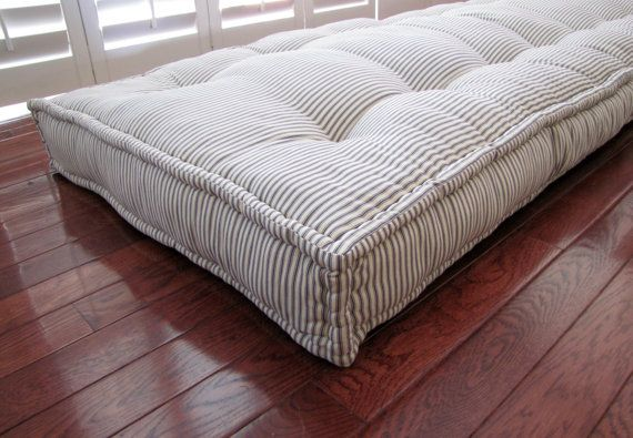 Custom French Mattress Cushions, shown in blue ticking stripe fabric. This soft and cozy overstuffed mattress cushion is hand tufted and quilted