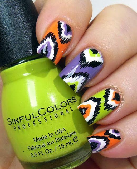 Halloween ikat manicure. purple, orange, and green.