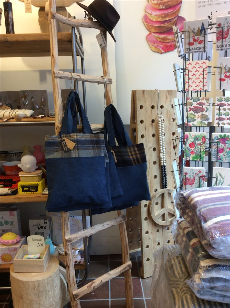 Lots of tweed and denim tote bags in the webshop. www.bakerstreethandmade.com