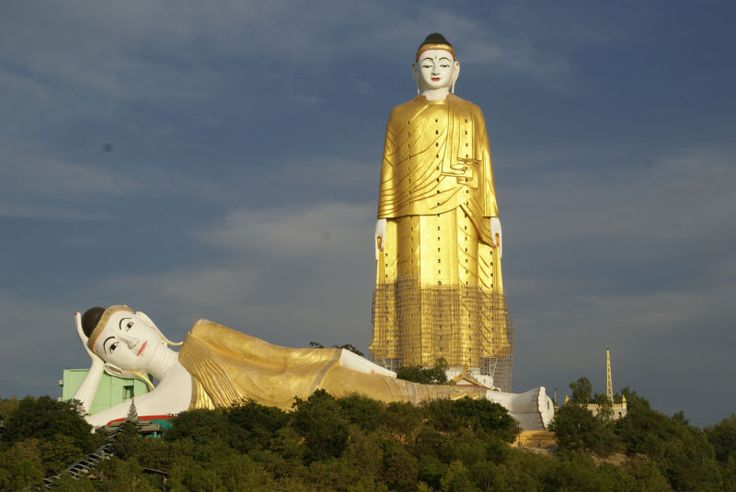 There is a smaller reclining Buddha right in front of the standing one, and there are thousands of Buddhism-themed painting and small sculptures inside the big one and around the complex.