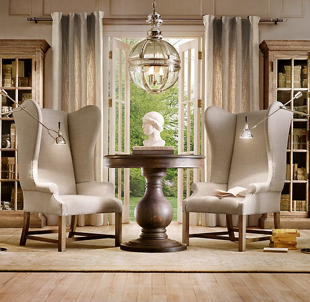 wingback chairs and the table looks like a chess piece