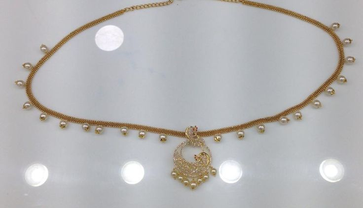 ITEM DESCRIPTION : Peacock model CZ stone with pearl drops chain model vaddanam TYPE : CZ LENGTH: 39-40 PRODUCT DETAILS : Micro gold plated polish COLOR : Gold