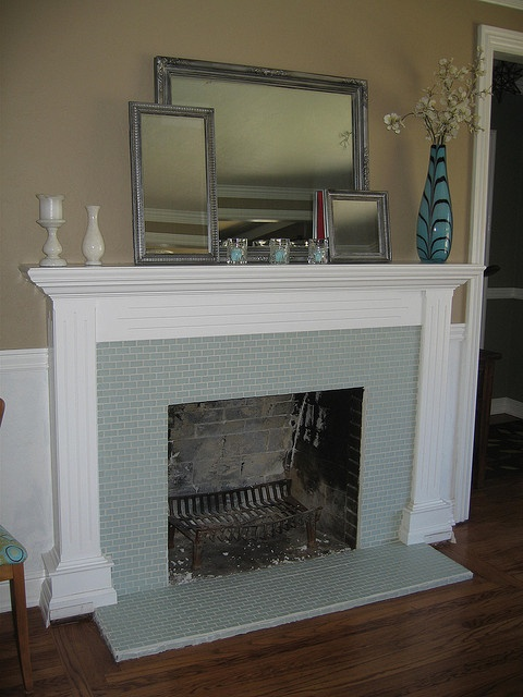 25 best ideas about glass tile fireplace on pinterest - Covering brick fireplace with tile ...