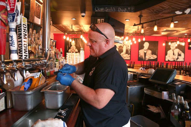 Shaun Murphy, an employee of Tibs Taps, a company that installs and maintains draft beer systems, cleans out the tap lines at Boston Burger Company.