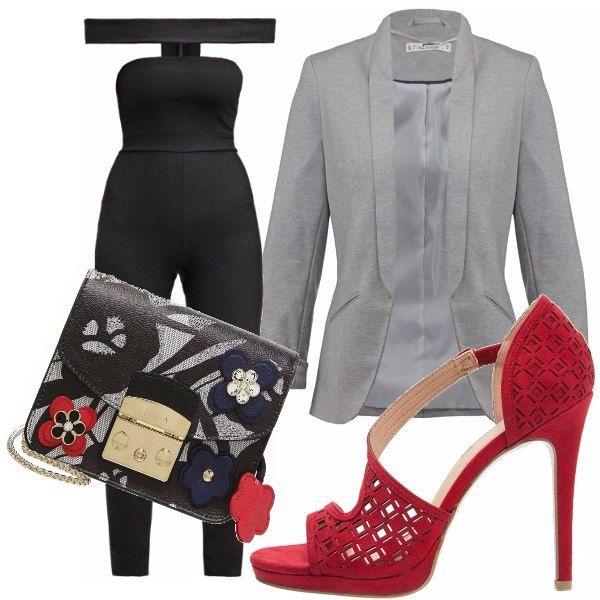 Questa jumpsuit è particolarissima e quindi ideale per una serata speciale. Le scarpe rosse, la borsa multicolor e il blazer grigio completano il look.