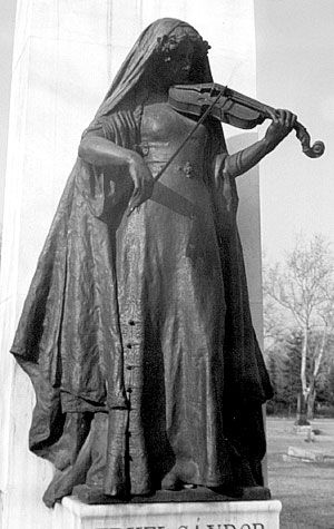 LADY PLAYING THE VIOLIN..Cemetery Statue, Hungary