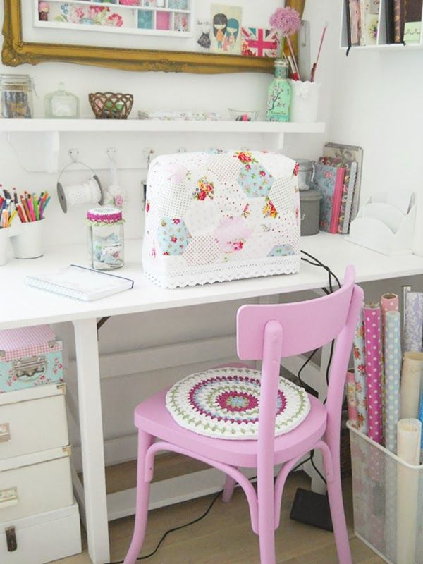 sewing space with a gorgeous pink painted chair and crochet seat pad