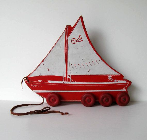 Hey, I found this really awesome Etsy listing at https://www.etsy.com/listing/232412291/antique-wood-pull-toy-sail-boat-beach