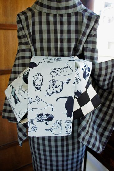 Rear view checkered black and white cat on gray mist Kasete band; recycled antique kimono