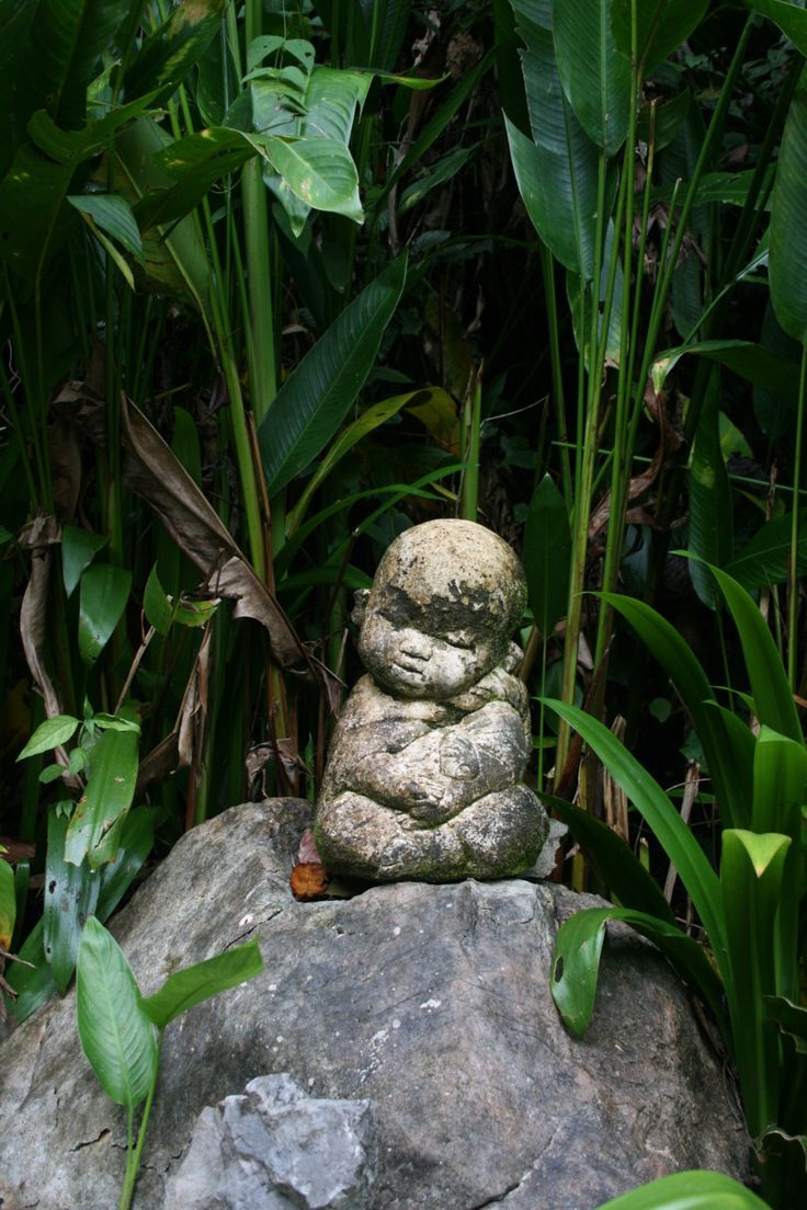 danceswithfaeriesunderthemoon:    tristanjbrigden:    I found this little fella' hiding in the undergrowth un-route to the chedi.    I love little statues like these :3