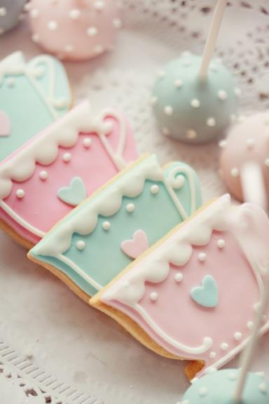 Adorable tea cup sugar cookies and pastel cake pops