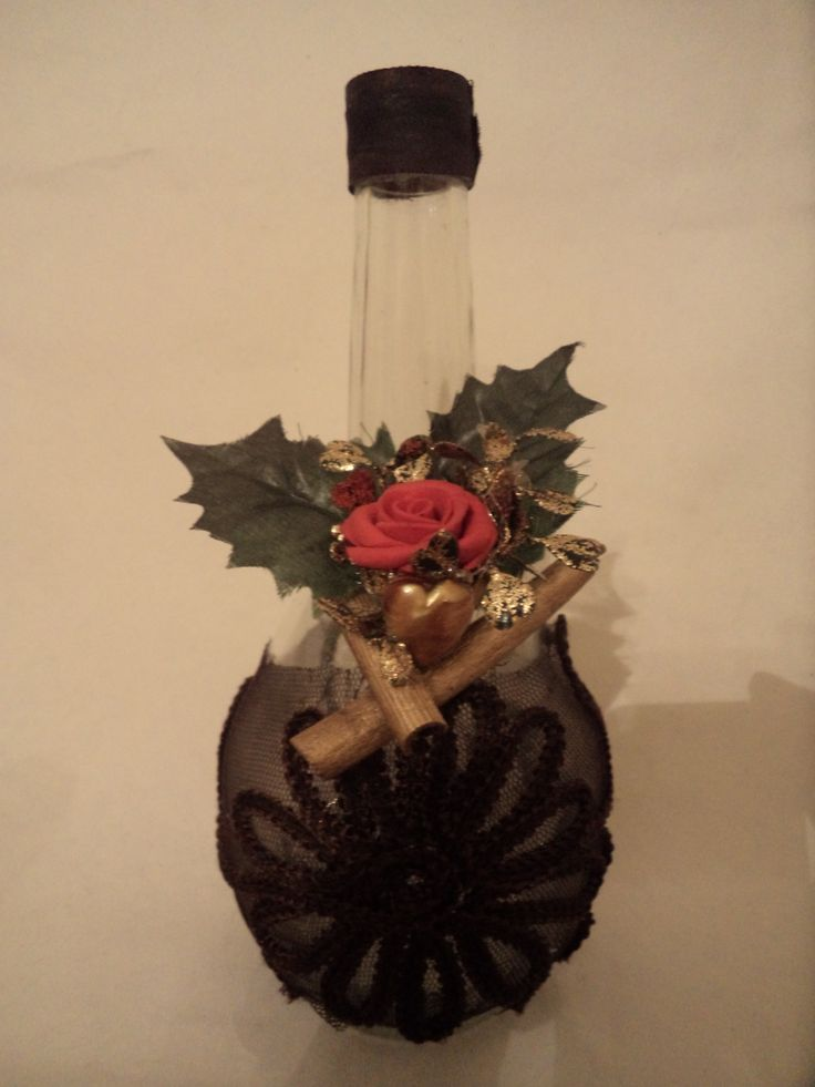 Vase decorated with leaves , red rose and gold details