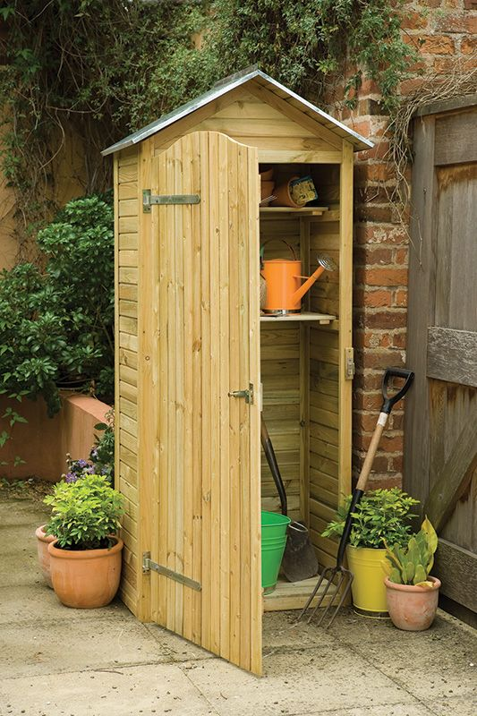 Tall Garden Store | This stylish garden tool store has a zinc roof for extra weather protection. It's small footprint makes it ideal for smaller gardens. It has two internal shelves and plenty of room underneath for long handled gardening tools. #gardenstorage