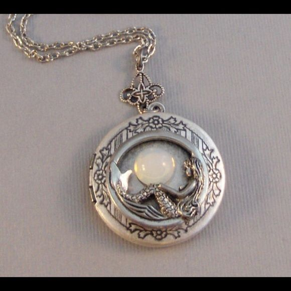Mermaid Locket, Mermaid Necklace, Mermaid Jewelry A beautiful handmade locket.  Is a lovely silver color. I have attached a vintage moonstone to the front of this lovely mermaid locket.  This locket is circle in shape. It does open and can hold two pictures inside. It comes complete with a 24 inch antique silver chain with a toggle clasp. Valleygirldesigns Jewelry Necklaces