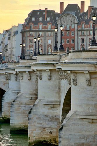 The Pont Neuf , is the oldest standing bridge across the river Seine in Paris. Its name (=New Bridge) was given to distinguish it from older bridges. It stands by the western point of the Île de la Cité.