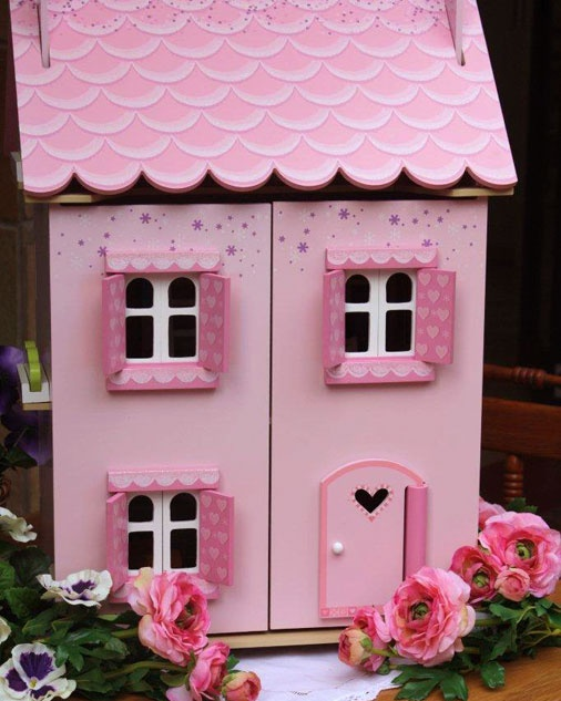 My First Dreamhouse - This gorgeous house is fully painted and decorated with heart motif opening shutters and windows – size 440 wide x 350 deep x 630 high. Price includes starter furniture set