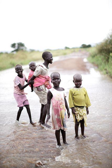 Children posing on flooded road