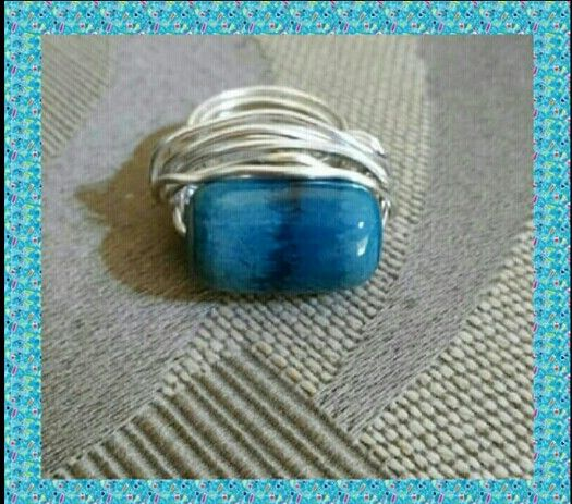 Ring with blue stone in aluminum wire.