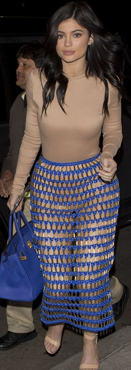 Kylie Jenner wearing Balmain and Hermes
