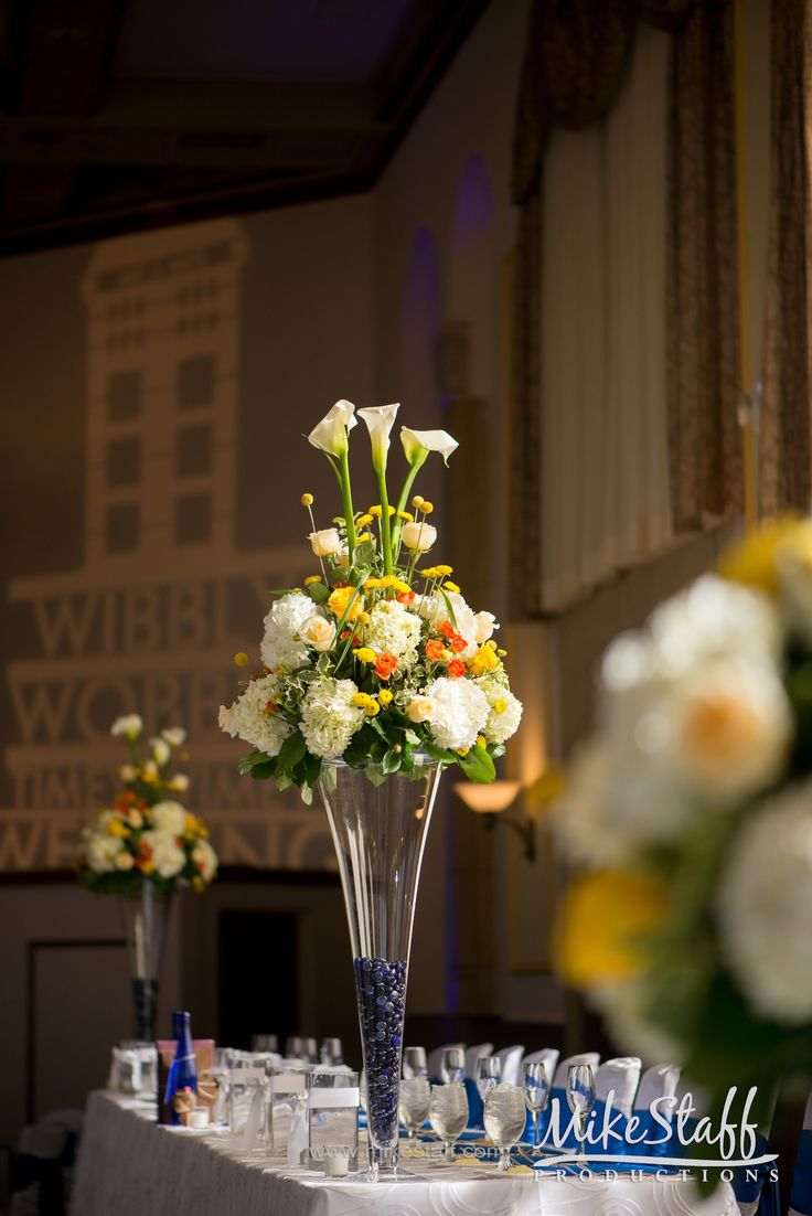 Tall glass centerpiece with yellow orange and white - Yellow and orange wedding decorations ...