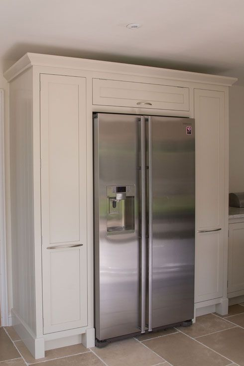 American fridge freezer surrounded by handmade cabinetry by Benchwood Kitchens www.benchwoodkitchens.co.uk
