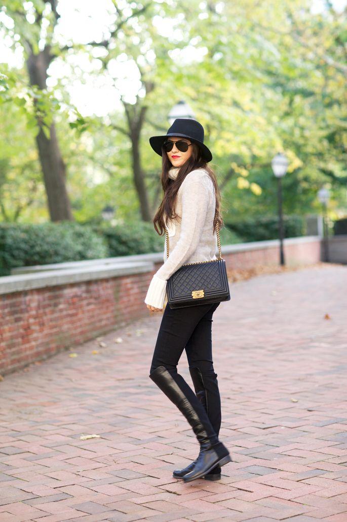 ivory Tory Burch sweater, black Hudson pants, black Stuart Weitzman 50/50 OTK boots, black Rag & Bone hat, black quilted Chanel bag