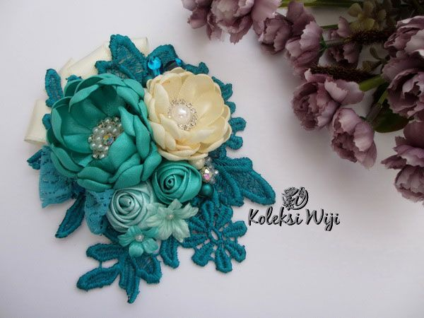 Gayatri Brooch  Size : 11 x 13 cm  Colours : Tosca  Materials : Satin flowers, satin rose, lace and beads.