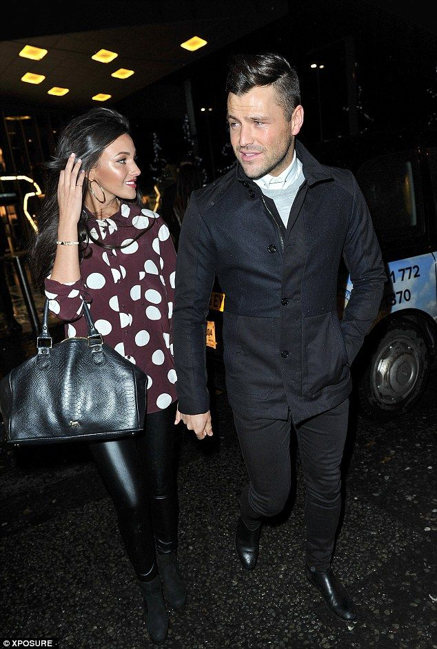 Michelle Keegan with Mark Wright.. polka dot blouse with black shiny leggings, boots and tote..