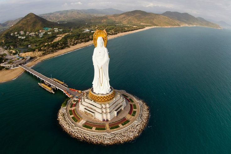 Guan Yin Of The South Sea, Sanya, China    The three sided statue of Guan Yin Buddha is located in Sanya Nanshan Buddhism Cultural Tourism Zone. The statue is larger than the statue of liberty, the 108-meter-tall statue stretches towards to the sea surface for about 400 meters.