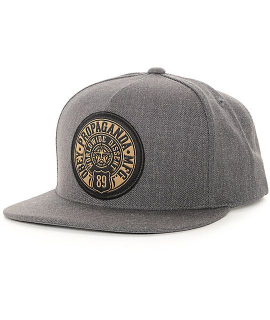 "Bring an iconic street style to your hat game with the Obey 89 Prop snapback hat. This snapback style features an ""Obey Propaganda Mfg 89 Worldwide Dissent"" icon star logo patch applied on the front of a stylish and comfortable acrylic-wool blended charco"