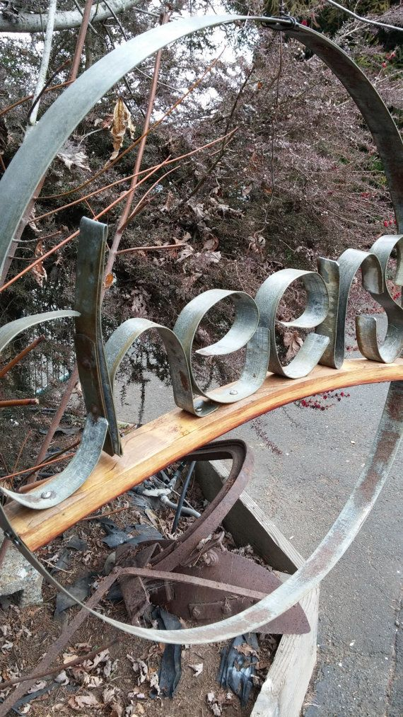 CHEERS...Wine barrel hoops made into a Cheers sign. A wine stave supports the metal hoop letters