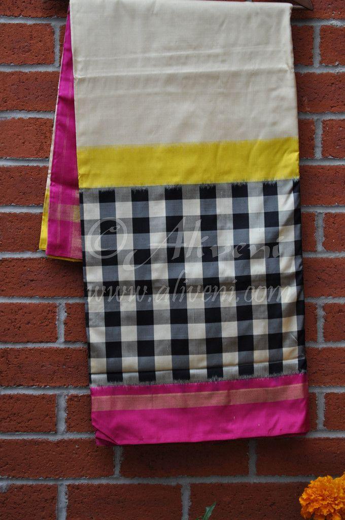 Cream Pochampally Ikat Saree with Broad Black/White checks and Pink/Yellow/Zari Borders