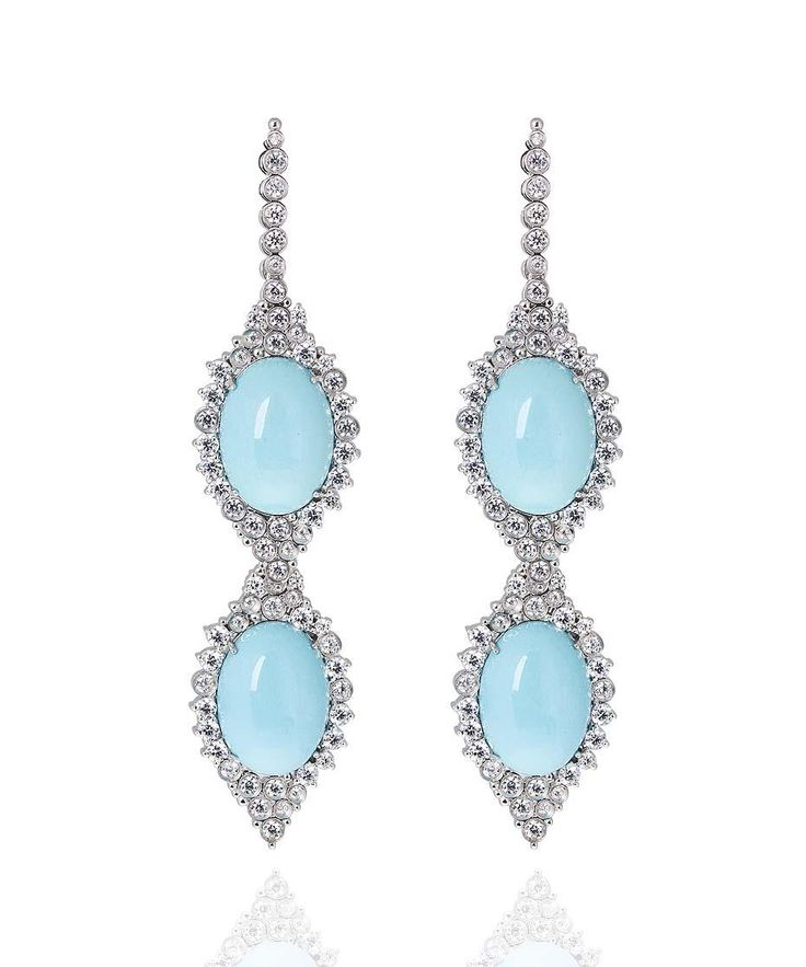 We have fallen in love with the rare Sleeping Beauty #turquoise in these #CarlaAmorim earrings http://ow.ly/L1Si5