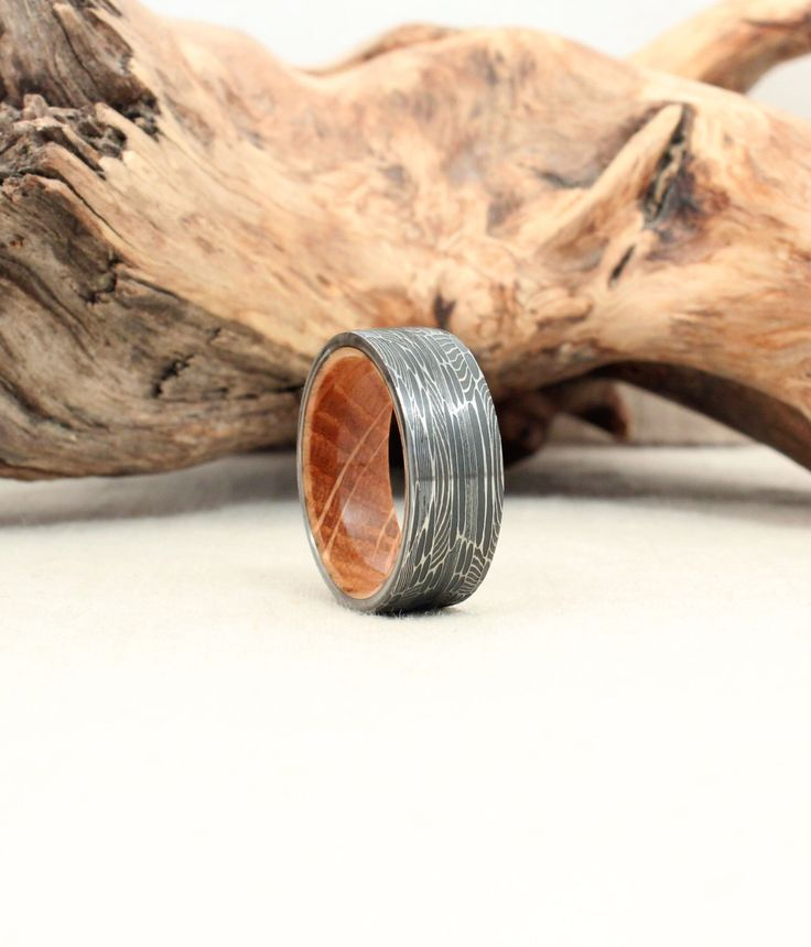 Damascus Steel and Wood Ring - Bourbon Barrel White Oak Stave Wood Ring Damascus Steel Ring by WedgewoodRings on Etsy https://www.etsy.com/listing/179491276/damascus-steel-and-wood-ring-bourbon
