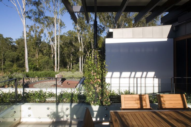 Samford House: Covered outdoor dining provides views onto surrounding landscape. See more at http://blighgraham.com.au/projects/samford-house-1