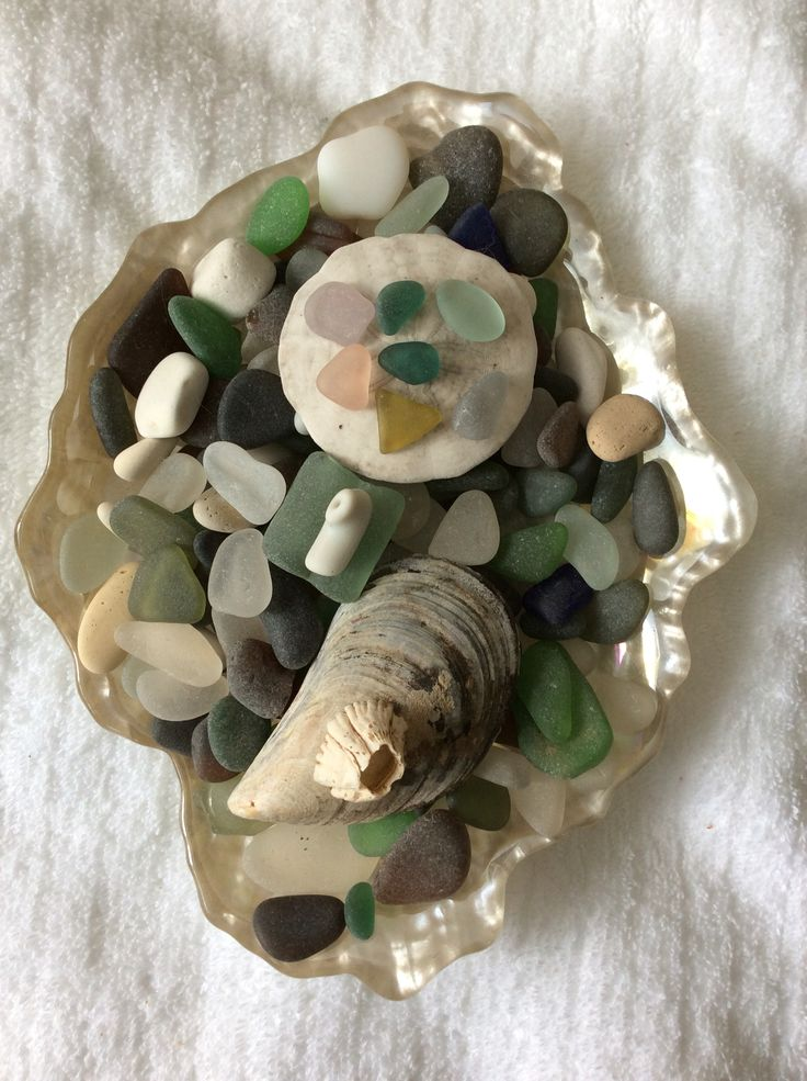 A small dish of favorite sea glass, she'll and sand dollar.