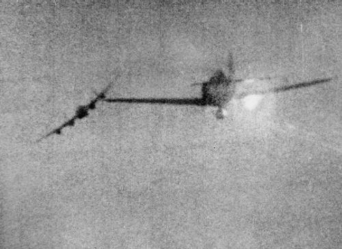 """""""Still from camera gun footage shot from a North American Mustang Mark III flown by Flying Officer J Butler of No. 65 Squadron RAF, as he shot down a Focke Wulf Fw 190D of II/JG26 which was attempting to attack an Avro Lancaster (banking, left), during a daylight raid by Bomber Command on the Gremberg railway yards at Cologne, Germany."""" (via)"""
