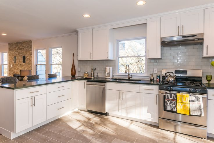 This bright, modern kitchen was designed by Cabinets Direct USA with WOLF Classic Cabinets in Dartmouth White. @cabinetsusa
