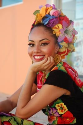idea for flowers and updo for her salsa dancer costume....maybe not soooo many flowers. make-up is how I want....
