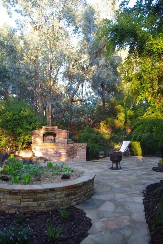 With a remnant bushland backdrop, this garden in Wattle Glen (Victoria, Australia), is a wonderful example of how traditional natives, indigenous plants and considered design create a sense of place. Sam Cox designed it with a food focus, recycled bricks and stone work.