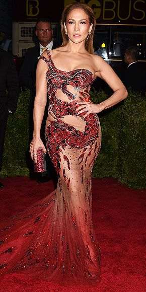 The Most Jaw-Dropping Dresses at the 2015 Met Gala | JENNIFER LOPEZ | in an ombré sequin dragon design in a super-revealing mermaid silhouette by Versace with matching red Swarovski clutch and eyeshadow.