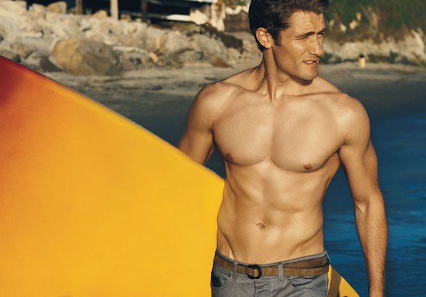GLEE star Matthew Morrison shirtless and holding an orange surfboard