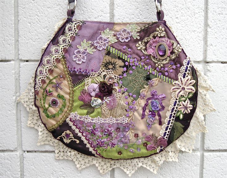 This handbag is not only gorgeous, but it won second place in Crazy Quilting International's Annual Purse Contest in 2009. Description from etsy.com. I searched for this on bing.com/images
