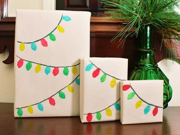 Christmas Light Garland  Kids can help craft this gift wrap that's as easy to create as it is cute. First, wrap gift in newsprint or butcher paper. Then, create a lightbulb-shaped stamp from a wine cork by cutting away the sides with a craft knife to leave just a pointed oval shape. Brush a light coat of paint onto the lightbulb portion of the stamp then firmly press it onto the wrapped gift.