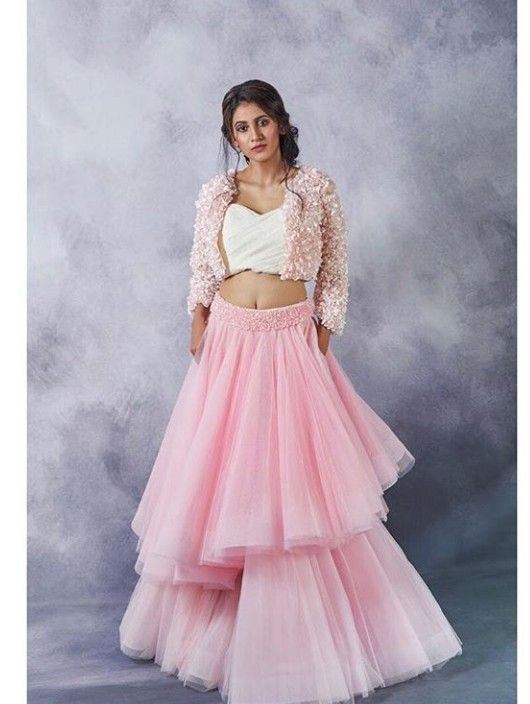 c16863479b21 Beautiful asymmetric net Lehenga with blouse top. Embellished with hand  embroidered jacket.