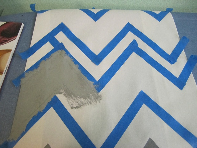Paint your own chevron fabric! I wanna staple this over an old canvas I have & hang above the bed. & possibly for a rug.