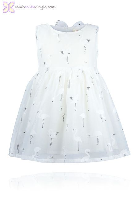 White Flamingo Dress. This cute-as-can-be White Flamingo Pattern Dress has the beauty and dressiness needed for a special occasion with some whimsical fun a young girl will love.